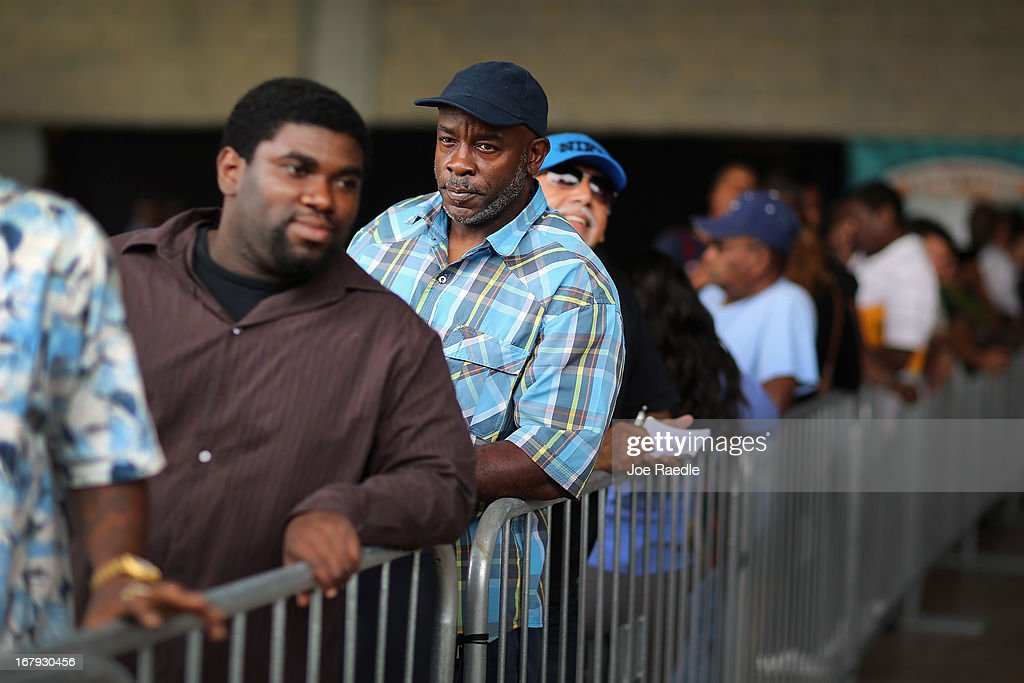 Dale Washington and other people looking for work stand in line to apply for jobs during a job fair at the Miami Dolphins Sun Life stadium on May 2, 2013 in Miami, Florida. If voters approve a hotel-tax hike to fund stadium renovations the jobs would be available if not the Dolphins management is indicating they would not be able to renovate the stadium nor create the jobs.