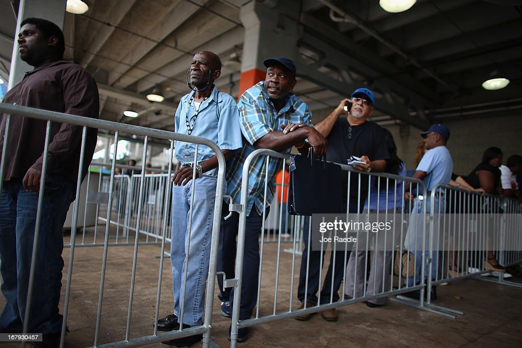 Dale Washington (C) and other people looking for work stand in line to apply for jobs during a job fair at the Miami Dolphins Sun Life stadium on May 2, 2013 in Miami, Florida. If voters approve a hotel tax hike to fund stadium renovations the jobs would be available. If not, the Dolphins management is indicating they would not be able to renovate the stadium nor create the jobs.