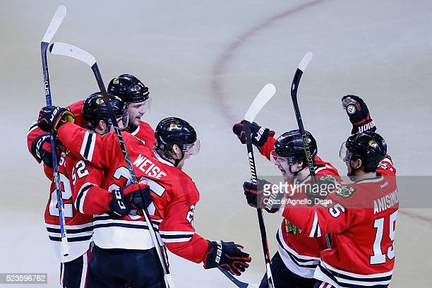 Dale Weise and Artemi Panarin of the Chicago Blackhawks react after Weise scored against the St Louis Blues to give the Chicago Blackhawks the lead...