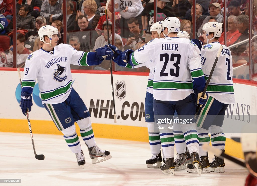 <a gi-track='captionPersonalityLinkClicked' href=/galleries/search?phrase=Dale+Weise&family=editorial&specificpeople=5527418 ng-click='$event.stopPropagation()'>Dale Weise</a> #32 and teammates of the Vancouver Canucks celebrate a goal against the Phoenix Coyotes at Jobing.com Arena on March 21, 2013 in Glendale, Arizona.