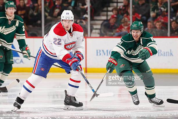 Dale Weise of the Montreal Canadiens and Zach Parise of the Minnesota Wild battle for the puck during the game on December 22 2015 at the Xcel Energy...
