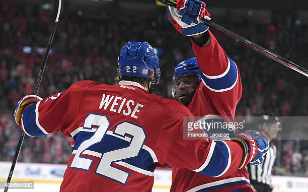 Dale Weise of the Montreal Canadiens celebrates after scoring a goal against the New York Islanders in the NHL game at the Bell Centre on November 5...
