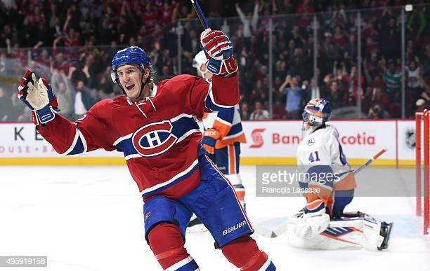 Dale Weise of the Montreal Canadiens celebrates after scoring a goal against Jaroslav Halak of the New York Islanders in the NHL game at the Bell...