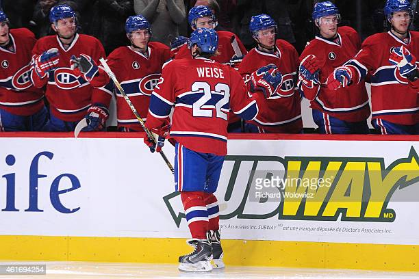 Dale Weise of the Montreal Canadiens celebrates his his second period goal with teammates during the NHL game against the New York Islanders at the...