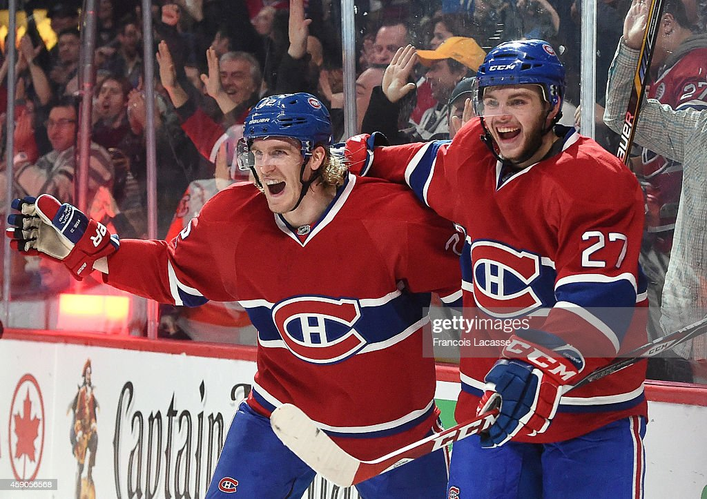 Dale Weise of the Montreal Canadiens celebrates with Alex Galchenyuk after scoring his second goal of the night against the Philadelphia Flyers in...