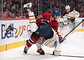 Dale Weise of the Montreal Canadiens checks Tyler Myers of the Buffalo Sabres in the NHL game at the Bell Centre on November 29 2014 in Montreal...