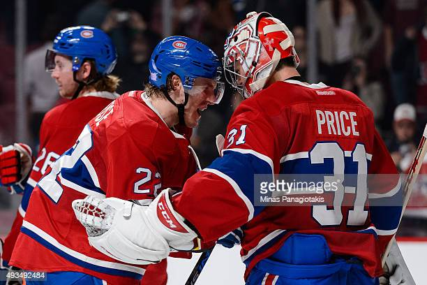 Dale Weise of the Montreal Canadiens congratulates goaltender Carey Price on his shutout victory during the NHL game against the St Louis Blues at...