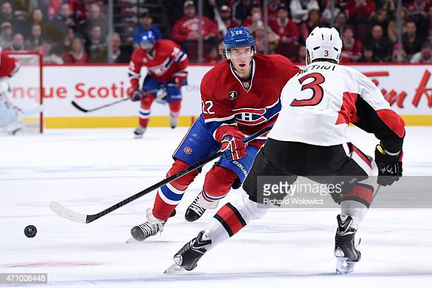 Dale Weise of the Montreal Canadiens passes the puck in front of Marc Methot of the Ottawa Senators during Game Five of the Eastern Conference...