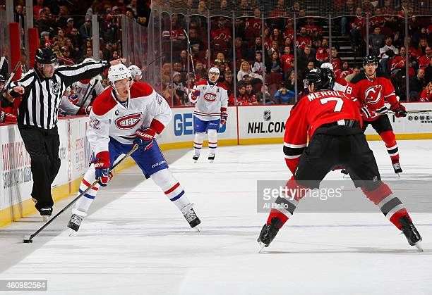 Dale Weise of the Montreal Canadiens skates against Jon Merrill of the New Jersey Devils during their game at the Prudential Center on January 2 2015...