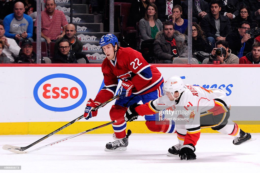 <a gi-track='captionPersonalityLinkClicked' href=/galleries/search?phrase=Dale+Weise&family=editorial&specificpeople=5527418 ng-click='$event.stopPropagation()'>Dale Weise</a> #22 of the Montreal Canadiens skates with the puck while being chased by <a gi-track='captionPersonalityLinkClicked' href=/galleries/search?phrase=Kris+Russell&family=editorial&specificpeople=879805 ng-click='$event.stopPropagation()'>Kris Russell</a> #4 of the Calgary Flames during the NHL game at the Bell Centre on February 4, 2014 in Montreal, Quebec, Canada. The Canadiens defeated the Flames 2-0.