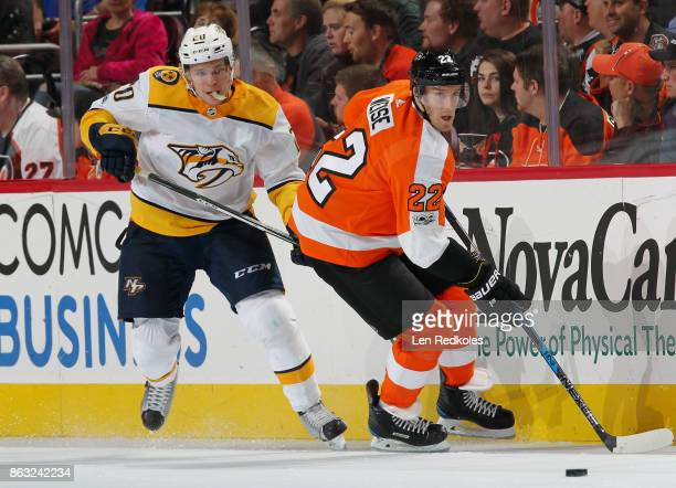 Dale Weise of the Philadelphia Flyers playing in his 400th NHL game controls the puck along the boards against Miika Salomaki of the Nashville...
