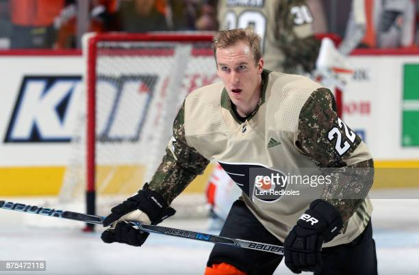 Dale Weise of the Philadelphia Flyers wearing a camouflage jersey in honor of Military Appreciation night warms up against the Minnesota Wild on...