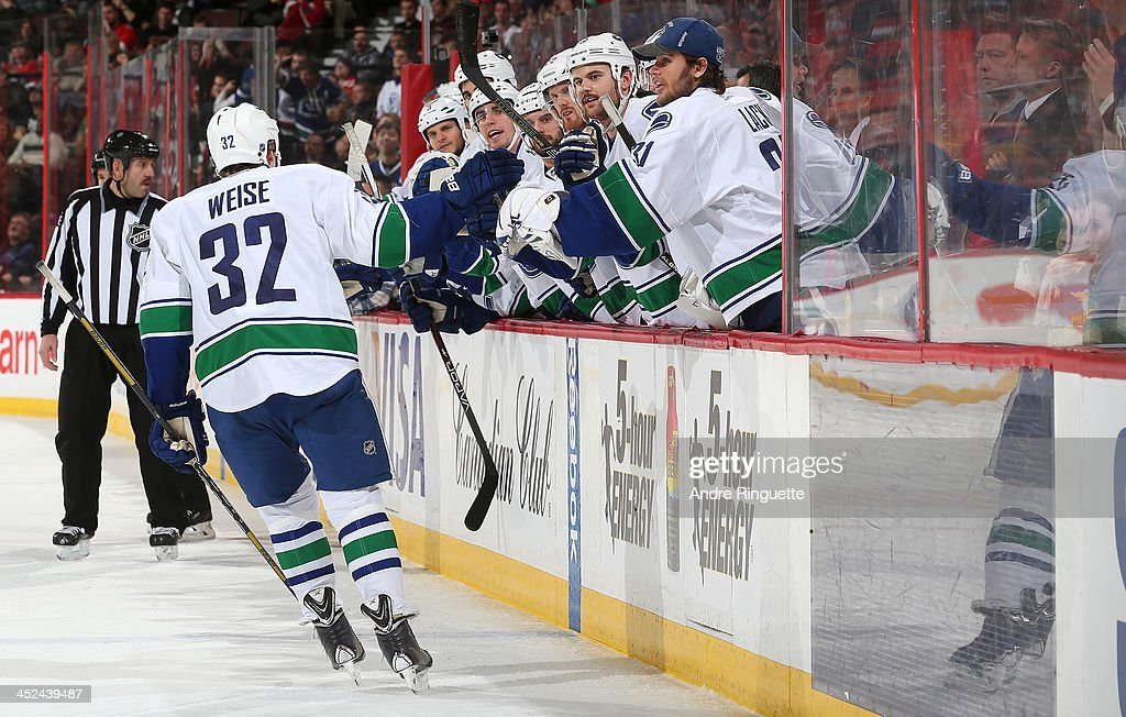 <a gi-track='captionPersonalityLinkClicked' href=/galleries/search?phrase=Dale+Weise&family=editorial&specificpeople=5527418 ng-click='$event.stopPropagation()'>Dale Weise</a> #32 of the Vancouver Canucks celebrates his second period goal against the Ottawa Senators at Canadian Tire Centre on November 28, 2013 in Ottawa, Ontario, Canada.