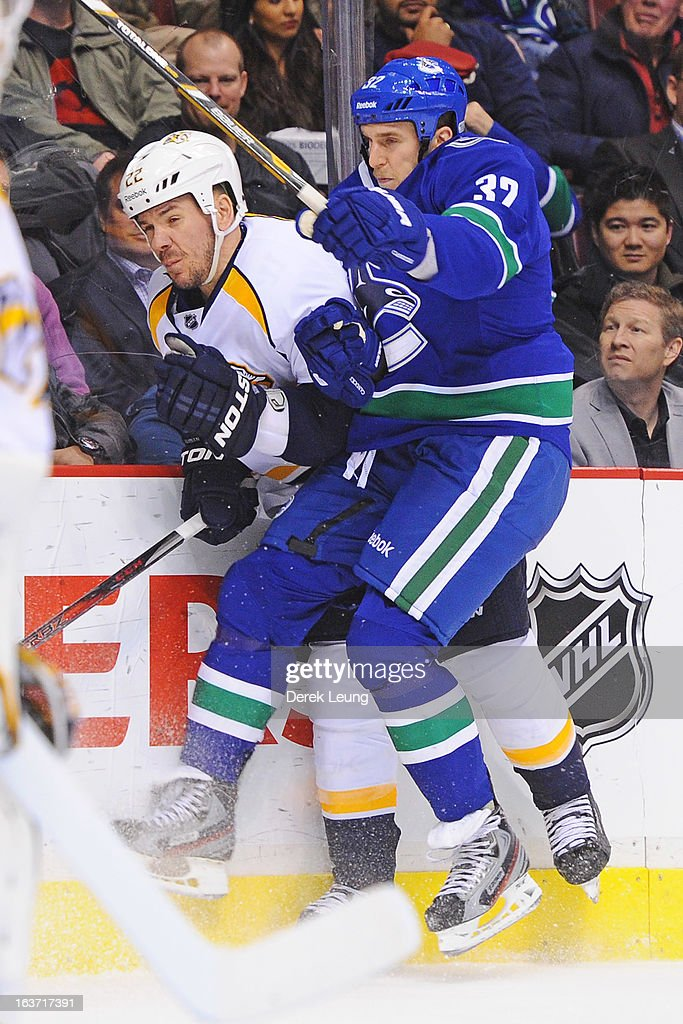 <a gi-track='captionPersonalityLinkClicked' href=/galleries/search?phrase=Dale+Weise&family=editorial&specificpeople=5527418 ng-click='$event.stopPropagation()'>Dale Weise</a> #32 of the Vancouver Canucks collides with <a gi-track='captionPersonalityLinkClicked' href=/galleries/search?phrase=Scott+Hannan&family=editorial&specificpeople=203195 ng-click='$event.stopPropagation()'>Scott Hannan</a> #22 of the Nashville Predators during an NHL game at Rogers Arena on March 14, 2013 in Vancouver, British Columbia, Canada. The Vancouver Canucks won 7-4.
