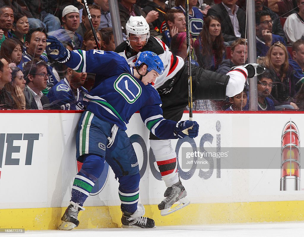 <a gi-track='captionPersonalityLinkClicked' href=/galleries/search?phrase=Dale+Weise&family=editorial&specificpeople=5527418 ng-click='$event.stopPropagation()'>Dale Weise</a> #32 of the Vancouver Canucks sand <a gi-track='captionPersonalityLinkClicked' href=/galleries/search?phrase=Bryce+Salvador&family=editorial&specificpeople=208746 ng-click='$event.stopPropagation()'>Bryce Salvador</a> #24 of the New Jersey Devils collide during their NHL game at Rogers Arena on October 8, 2013 in Vancouver, British Columbia, Canada. Vancouver won 3-2.