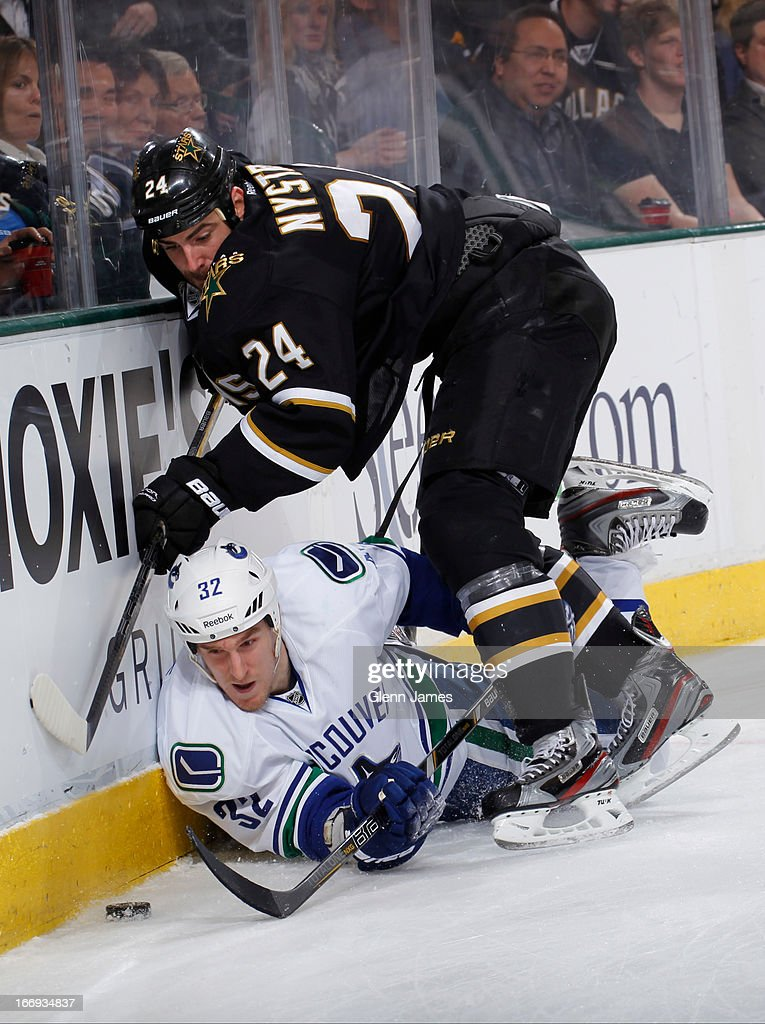 <a gi-track='captionPersonalityLinkClicked' href=/galleries/search?phrase=Dale+Weise&family=editorial&specificpeople=5527418 ng-click='$event.stopPropagation()'>Dale Weise</a> #32 of the Vancouver Canucks tries to keep the puck away against <a gi-track='captionPersonalityLinkClicked' href=/galleries/search?phrase=Eric+Nystrom&family=editorial&specificpeople=2209813 ng-click='$event.stopPropagation()'>Eric Nystrom</a> #24 of the Dallas Stars at the American Airlines Center on April 18, 2013 in Dallas, Texas.