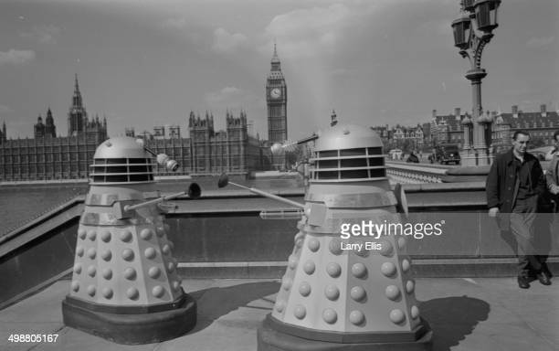Dalek robots from the BBC television show 'Doctor Who' along the Thames River next to the Houses of Parliament Lodnon August 20th 1964