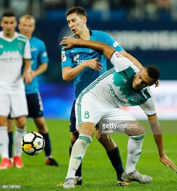 Daler Kuzyaev of FC Zenit Saint Petersburg and Leo Jaba of FC Akhmat Grozny vie for the ball during the Russian Football League match between FC...