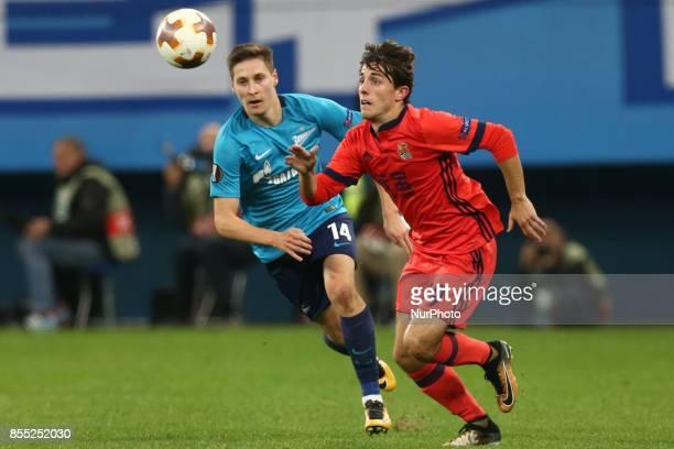 Daler Kuzyaev of FC Zenit Saint Petersburg and Álvaro Odriozola of FC Real Sociedad vie for the ball during the UEFA Europa League Group L football...