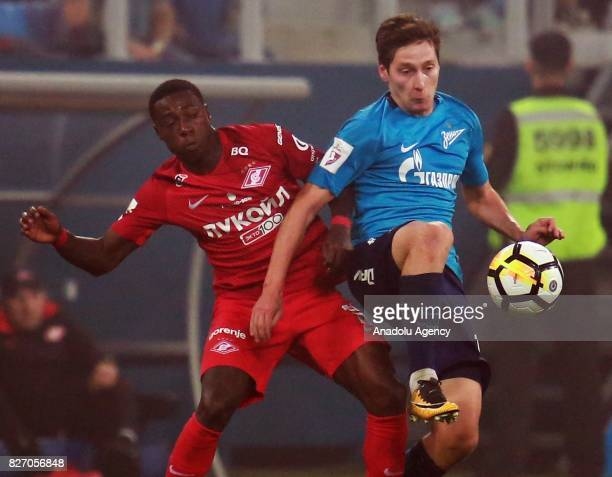 Daler Kuzyaev of FC Zenit SaintPetersburg in action against Quincy Promes of FC Spartak Moscow during the Russian Premiere League match between Zenit...
