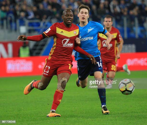 Daler Kuzyaev of FC Zenit St Petersburg vies for the ball with Stophira Sunzu of FC Arsenal Tula during the during the Russian Premier League match...