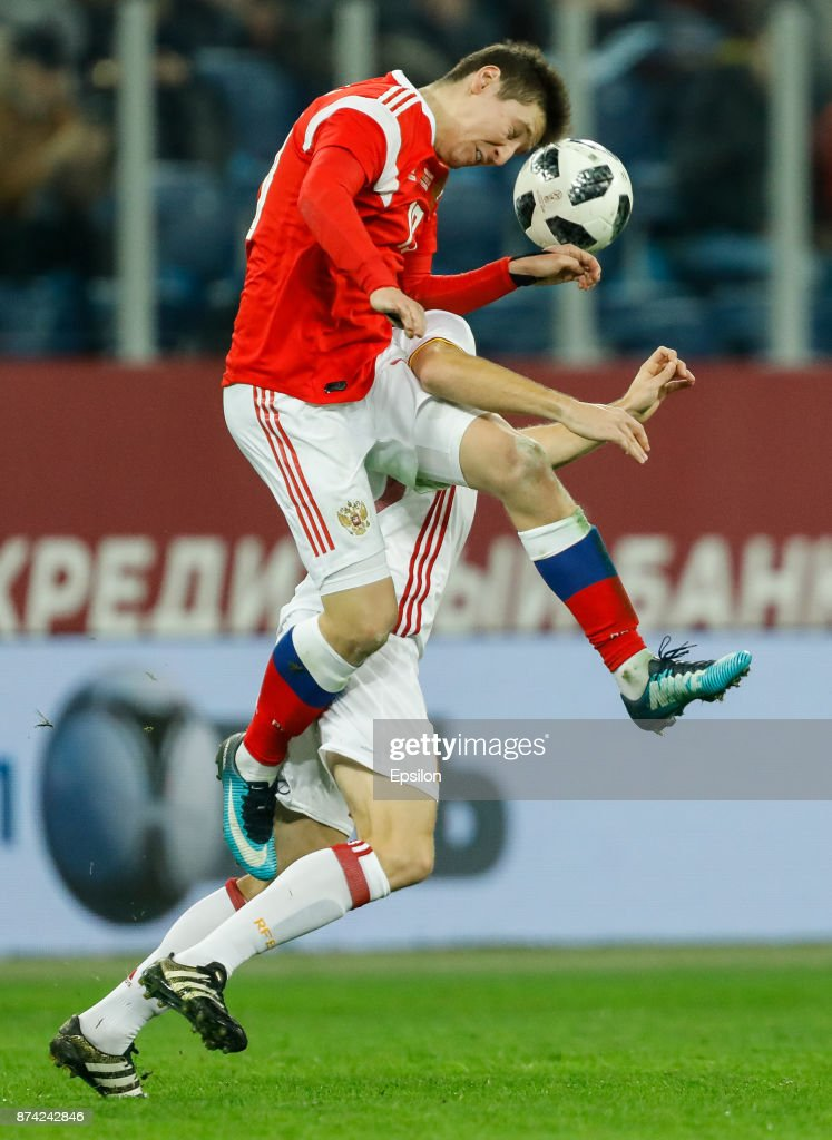 Daler Kuzyaev (in front) of Russia vies for the ball with Asier Illarramendi of Spain during Russia and Spain International friendly match on November 14, 2017 at Saint Petersburg Stadium in Saint Petersburg, Russia.