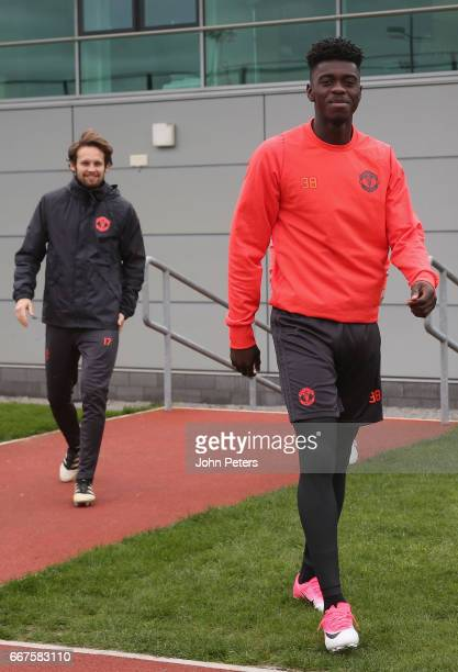 Daley Blind and Axel Tuanzebe of Manchester United walk out ahead of a first team training session at Aon Training Complex on April 12 2017 in...