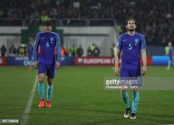 Daley Blind and Kevin Strootman of Netherlands look dejected as they leave the field after their loss during the FIFA 2018 World Cup Qualifier Group...