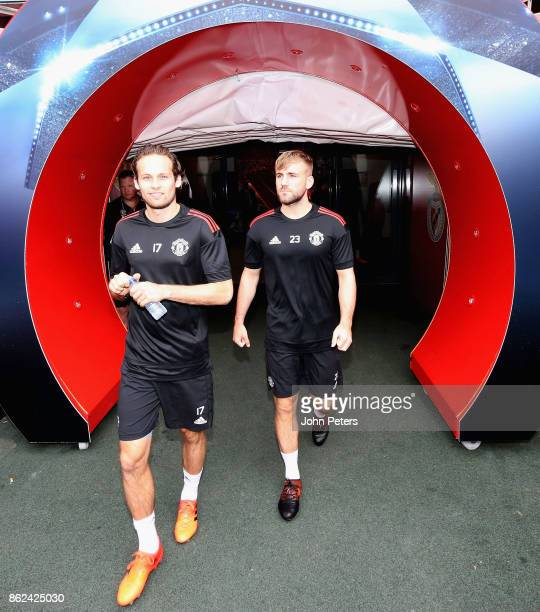 Daley Blind and Luke Shaw of Manchester United in action during a training session ahead of their UEFA Champions League match against Benfica on...