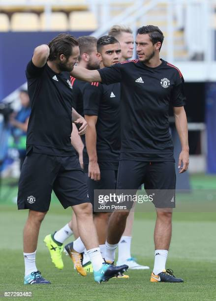 Daley Blind and Matteo Darmian of Manchester United in action during a training session ahead of the UEFA Super Cup match between Manchester United...