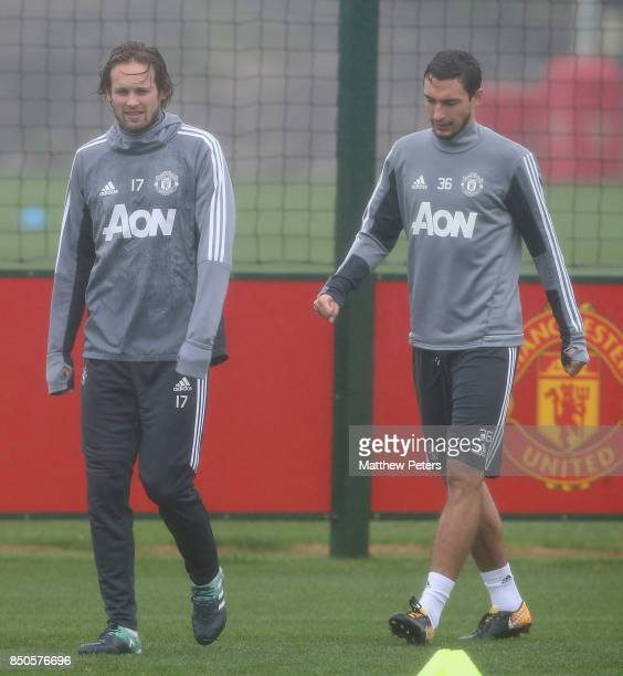 Daley Blind and Matteo Darmian of Manchester United in action during a first team training session at Aon Training Complex on September 21 2017 in...
