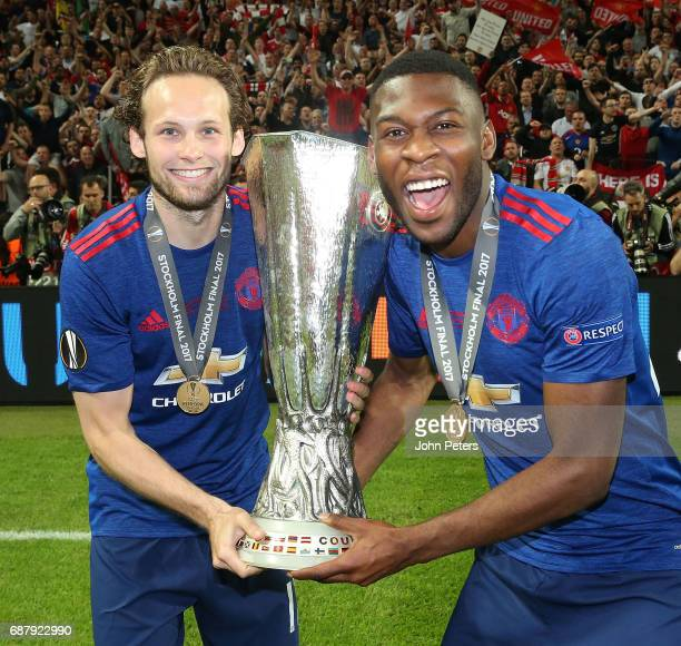 Daley Blind and Timothy FosuMensah of Manchester United celebrate with the Europa League trophy after the UEFA Europa League Final match between...