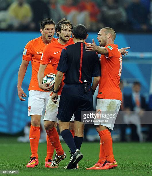 Daley Blind and Wesley Sneijder of the Netherlands appeal to referee Cuneyt Cakir during the 2014 FIFA World Cup Brazil Semi Final match between...