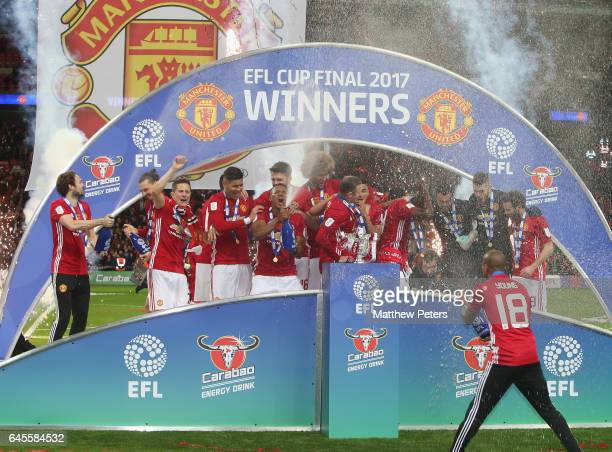 Daley Blind Ander Herrera Marcos Rojo Antonio Valencia Wayne Rooney and Ashley Young of Manchester United celebrate after the EFL Cup Final match...