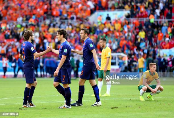 Daley Blind Daryl Janmaat and Stefan de Vrij of the Netherlands celebrate after defeating Australia 32 during the 2014 FIFA World Cup Brazil Group B...