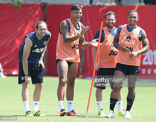 Daley Blind Marcos Rojo Juan Mata and Memphis Depay of Manchester United in action during a first team training session as part of their preseason...