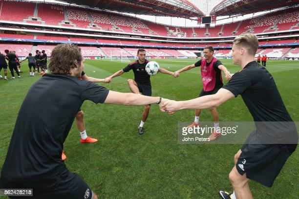 Daley Blind Matteo Darmian Nemanja Matic and Scott McTominay of Manchester United in action during a training session ahead of their UEFA Champions...