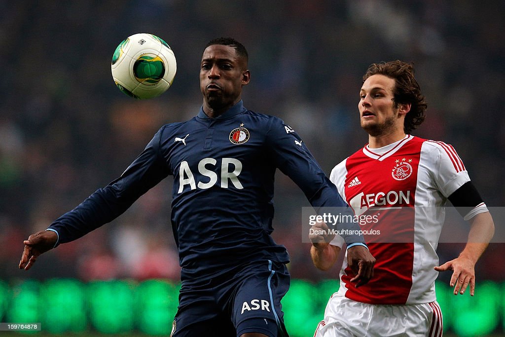 Daley Blind (R) of Ajax and Bruno Martins Indi of Feyenoord battle for the ball during the Eredivisie match between Ajax Amsterdam and Feyenoord Rotterdam at Amsterdam Arena on January 20, 2013 in Amsterdam, Netherlands.