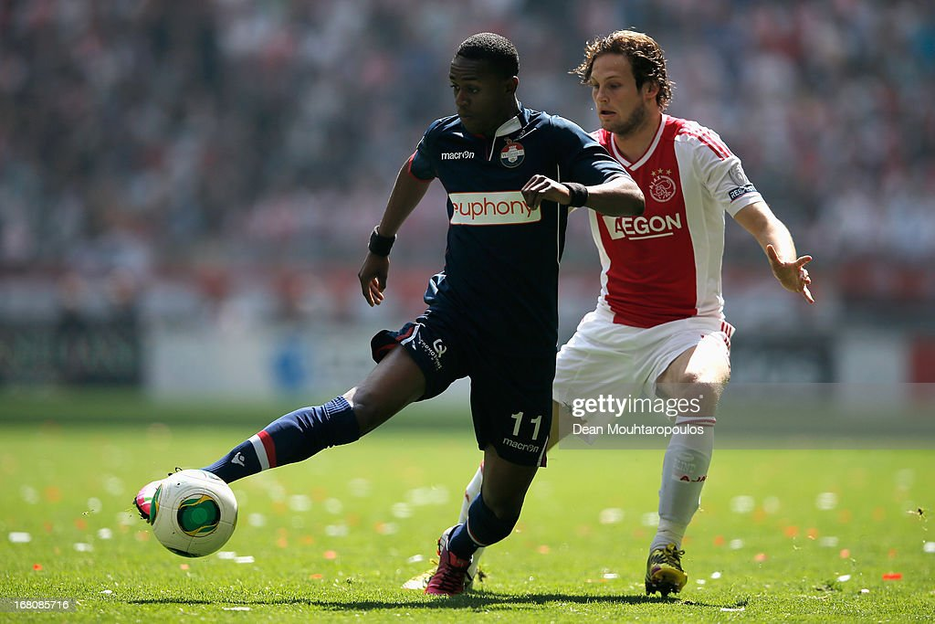 Daley Blind of Ajax and Virgil Misidjan of Willem II battle for the ball during the Dutch Eredivisie match between Ajax and Willem II Tilburg at Amsterdam Arena on May 5, 2013 in Amsterdam, Netherlands.
