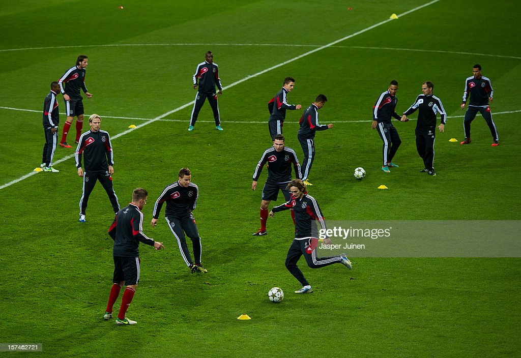 Daley Blind (R) of Ajax kicks the ball during a training session with his teammates ahead of the UEFA Champions League match between AFC Ajax and Real Madrid CF at the Estadio Santiago Bernabeu on December 3, 2012 in Madrid, Spain.
