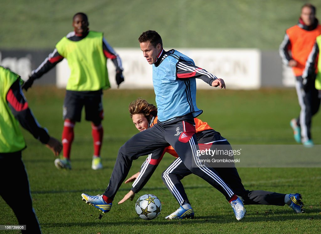 Daley Blind of Amsterdam and teammate Derk Boerrigter battle for the ball during a training session ahead of the UEFA Champions League match against Borussia Dortmund on November 20, 2012 in Amsterdam, Netherlands.