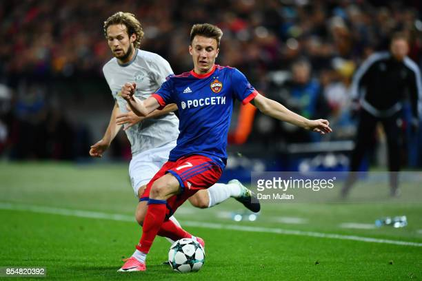 Daley Blind of Manchester United and Aleksandr Golovin of CSKA Moscow battle for the ball during the UEFA Champions League group A match between CSKA...