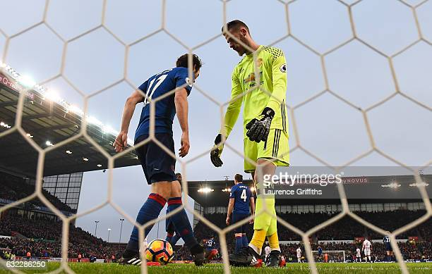 Daley Blind of Manchester United and David De Gea of Manchester United R look dejected after Stoke City score during the Premier League match between...