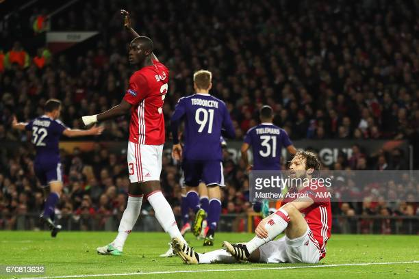Daley Blind of Manchester United and Eric Bailly react after Sofiane Hanni of Anderlecht scored his team's first goal to make the score 11 during the...