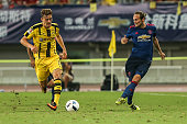 Daley Blind of Manchester United and Jacob Bruun Larsen of Borussia Dortmund compete for the ball during the 2016 International Champions Cup China...