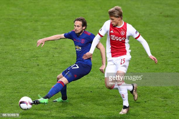 Daley Blind of Manchester United and Kasper Dolberg of Ajax battle for possession during the UEFA Europa League Final between Ajax and Manchester...
