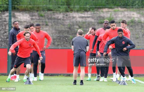 Daley Blind of Manchester United and Marcus Rashford of Manchester United take part in a drill during a Manchester United training session ahead of...