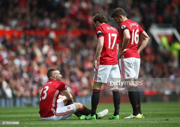 Daley Blind of Manchester United and Michael Carrick of Manchester United check is Luke Shaw of Manchester United is okay after he goes down holding...