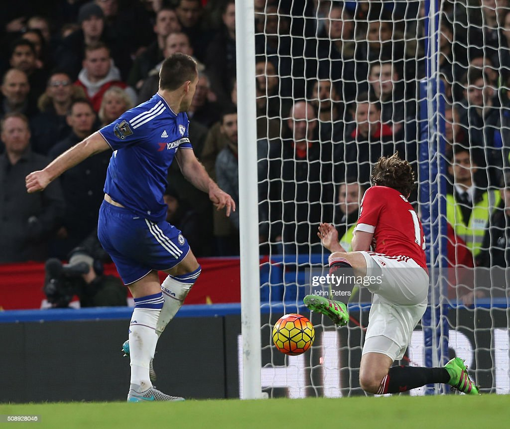 <a gi-track='captionPersonalityLinkClicked' href=/galleries/search?phrase=Daley+Blind&family=editorial&specificpeople=5566498 ng-click='$event.stopPropagation()'>Daley Blind</a> of Manchester United blocks a shot by <a gi-track='captionPersonalityLinkClicked' href=/galleries/search?phrase=John+Terry&family=editorial&specificpeople=171535 ng-click='$event.stopPropagation()'>John Terry</a> of Chelsea during the Barclays Premier League match between Chelsea and Manchester United at Stamford Bridge on February 7 2016 in London, England.