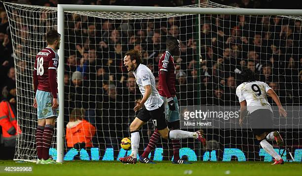 Daley Blind of Manchester United celebrates after scoring their first goal during the Barclays Premier League match between West Ham United and...